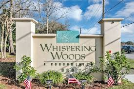 homes in whispering woods